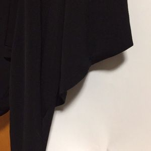 Black open front cover with 3/4 sleeve.